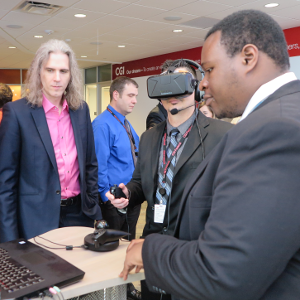 Dr. Borst and Sam Ekong demonstrating  the Virtual Energy Center at CGI